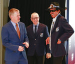Former NASCAR drivers from left to right, Jeff Burton, Mark Martin and Richard Petty have a conversation on the red carpet before the NASCAR Hall of Fame induction ceremony for the Class of 2019, Friday, Feb. 1, 2019, in Charlotte, N.C. (AP Photo/Jason E. Miczek)