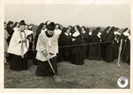 In this photo from 1950 provided by the Congregation of St. Joseph, priests and nuns participate in a groundbreaking ceremony for the Mirabeau Provincial House in New Orleans. For more than a century, New Orleans has depended on canals and pumps to get rid of stormwater in a city that is largely below sea level. Now a city that expanded by filling in wetlands is spending $270 million to create spaces for stormwater, like the water garden on a 25-acre site provided by nuns who lived there before Hurricane Katrina. It's also installing underground holding tanks, porous pavement and other measures to reduce storm flooding and the stress on huge pumps built in the 1910s.(Congregation of St. Joseph via AP)