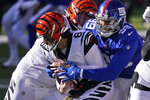 New York Giants defensive end Leonard Williams (99) tackles Cincinnati Bengals quarterback Brandon Allen (8) during the first half of an NFL football game, Sunday, Nov. 29, 2020, in Cincinnati. (AP Photo/Bryan Woolston)