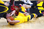 Iowa center Luka Garza, left, fights for a loose ball with Rutgers guard Caleb McConnell during the first half of an NCAA college basketball game, Wednesday, Jan. 22, 2020, in Iowa City, Iowa. (AP Photo/Charlie Neibergall)