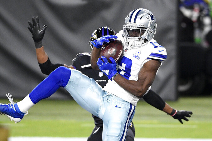 Dallas Cowboys wide receiver Michael Gallup, front, makes a touchdown catch on a pass from quarterback Andy Dalton, not visible, against Baltimore Ravens cornerback Marlon Humphrey during the first half of an NFL football game, Tuesday, Dec. 8, 2020, in Baltimore. (AP Photo/Nick Wass)