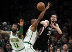 Washington Wizards guard Tomas Satoransky (31) passes the ball under pressure from Boston Celtics center Al Horford as Celtics guard Kyrie Irving (11) defends during the first quarter of an NBA basketball game Friday, March 1, 2019, in Boston. (AP Photo/Elise Amendola)