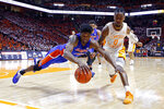 Florida center Kevarrius Hayes (13) dives for the ball ahead of Tennessee guard Jordan Bone (0) during the second half of an NCAA college basketball game, Saturday, Feb. 9, 2019, in Knoxville, Tenn. Tennessee won 73-61. (AP photo/Wade Payne)