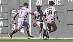 San Francisco Giants center fielder Kevin Pillar (1), shortstop Mauricio Dubon (19) and left fielder Joey Rickard, center, all chase down a single by Boston Red Sox's Rafael Devers during the second inning of a baseball game at Fenway Park in Boston, Thursday, Sept. 19, 2019. (AP Photo/Charles Krupa)