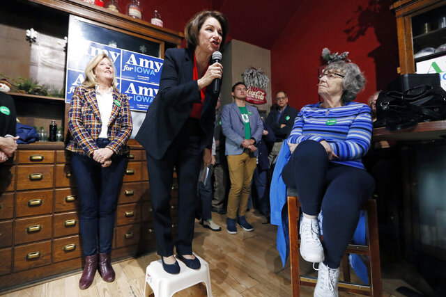 FILE - In this Dec. 6, 2019, file photo, Democratic presidential candidate Sen. Amy Klobuchar, D-Minn., speaks during a stop at the Corner Sundry in Indianola, Iowa. Democrat Amy Klobuchar says she will become the first major 2020 candidate to have visited all 99 Iowa counties after stops scheduled for Friday in the lead off caucus state. (AP Photo/Charlie Neibergall, File)