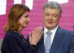 Ukrainian President Petro Poroshenko's wife Maryna stands with her husband at his headquarters after the second round of presidential elections in Kiev, Ukraine, Sunday, April 21, 2019. Ukrainian President Petro Poroshenko is accepting defeat in the election for the country's top post. (AP Photo/Efrem Lukatsky)
