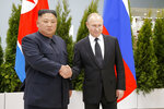 FILE - In this April 25, 2019, file photo, Russian President Vladimir Putin, right, and North Korea's leader Kim Jong Un shake hands during their meeting in Vladivostok, Russia. Kim's fifth meeting with Chinese President Xi Jinping continues his ambitious diplomatic outreach that has included summits with the leaders of the United States, South Korea and Russia in the past year and a half. Experts say Kim is attempting to form a united front with North Korea's main ally China to strengthen his leverage in the stalled nuclear negotiations with the United States. (AP Photo/Alexander Zemlianichenko, Pool, File)