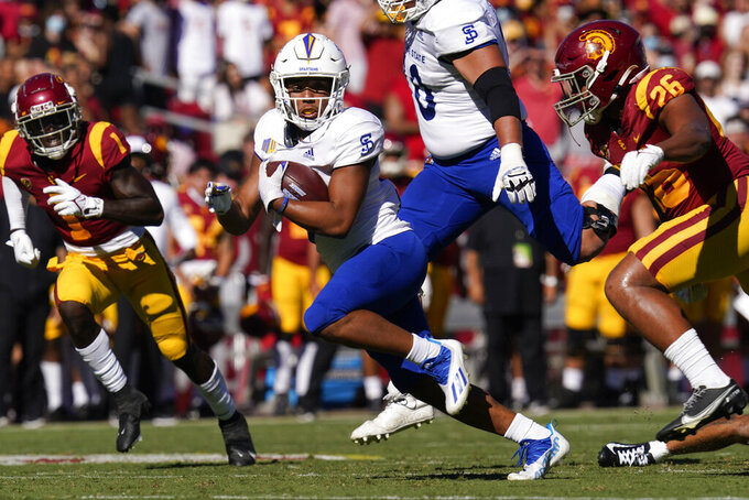 San Jose State wide receiver Isaiah Hamilton, center, runs the ball during the second half of an NCAA college football game against Southern California Saturday, Sept. 4, 2021, in Los Angeles. (AP Photo/Ashley Landis)