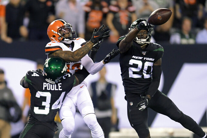 New York Jets free safety Marcus Maye (20) deflects a pass to Cleveland Browns' Odell Beckham (13) as Jets cornerback Brian Poole (34) also defends during the first half of an NFL football game Monday, Sept. 16, 2019, in East Rutherford, N.J. (AP Photo/Bill Kostroun)
