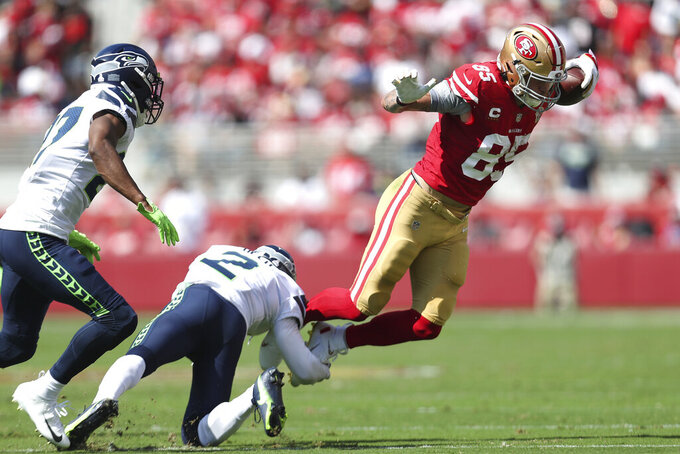 San Francisco 49ers tight end George Kittle (85) runs against Seattle Seahawks cornerback D.J. Reed (2) and defensive back Marquise Blair during the first half of an NFL football game in Santa Clara, Calif., Sunday, Oct. 3, 2021. (AP Photo/Jed Jacobsohn)
