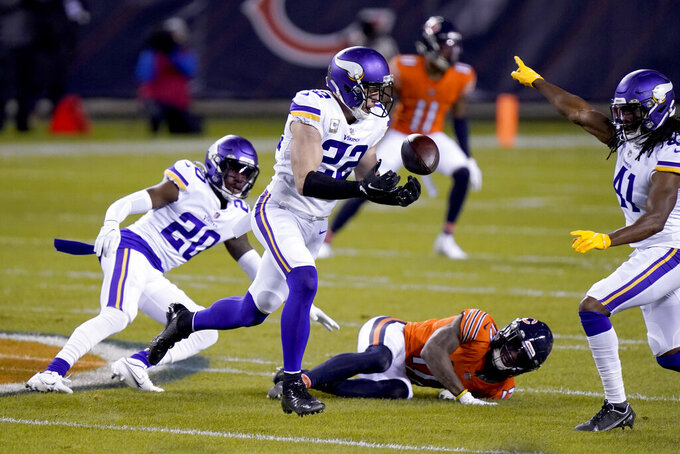 Minnesota Vikings safety Harrison Smith (22) intercepts a pass as teammates cornerback Jeff Gladney (20) and safety Anthony Harris (41) watch along with Chicago Bears wide receiver Anthony Miller (17) during the first half of an NFL football game Monday, Nov. 16, 2020, in Chicago. (AP Photo/Nam Y. Huh)