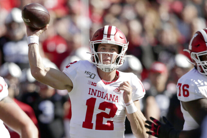 Indiana quarterback Peyton Ramsey (12) throws a pass during the first half of an NCAA college football game against Nebraska in Lincoln, Neb., Saturday, Oct. 26, 2019. (AP Photo/Nati Harnik)