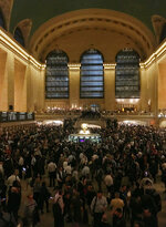 Commuters are stranded during the evening commute at Grand Central Terminal in New York on Tuesday, May 15, 2018. The Metro-North commuter railroad said Tuesday evening that downed trees across the tracks had caused it to suspend service on its Harlem, Hudson and New Haven lines. Entrances to Grand Central Terminal were closed and passengers were being turned away to prevent the station from getting too crowded. (AP Photo/Donald King)