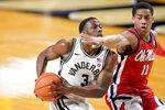 Vanderbilt's Maxwell Evans (3) drives against Mississippi's Matthew Murrell (11) in the first half of an NCAA college basketball game Saturday, Feb. 27, 2021, in Nashville, Tenn. (AP Photo/Mark Humphrey)