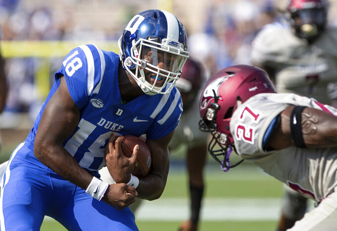 FILE - In this Saturday, Sept. 22, 2018, file photo, Duke quarterback Quentin Harris (18) carries the ball as North Carolina Central's Jaquell Taylor (27) looks for a tackle during the first half of an NCAA college football game in Durham, N.C. An offensive breakout has helped jumpstart Georgia Tech's season. Duke coach David Cutcliffe would like to see his offense enjoy a similar resurgence following the Blue Devils' first loss of the season. Duke visits Georgia Tech on Saturday in a key game for each team's effort to contend in the Atlantic Coast Conference's Coastal Division. (AP Photo/Ben McKeown, File)