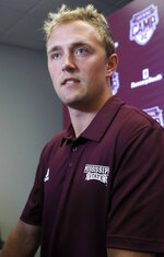 Mississippi State quarterback Tommy Stevens answers a reporter's question about competition among quarterbacks in preseason camp as they prepare for the upcoming NCAA college football season during media day, Saturday, Aug. 10, 2019, in Starkville, Miss. (AP Photo/Rogelio V. Solis)