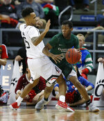 FILE  - In this Dec. 21, 2017, file photo, then-Cleveland State guard Tyree Appleby, right, drives the ball around Cincinnati guard Cane Broome (15) during the second half of an NCAA college basketball game in Highland Heights, Ky. Unlike a year ago, Florida begins the season unranked and won't have nearly as much hype even though they return seven of their top nine scorers and add four transfers, including yree Appleby. (AP Photo/Gary Landers, File)