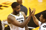 Missouri's Jeremiah Tilmon, left, celebrates with Javon Pickett after he came off the court during the second half of the team's NCAA college basketball game against South Carolina on Tuesday, Jan. 19, 2021, in Columbia, Mo. Missouri won 81-70. (AP Photo/L.G. Patterson)