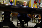 President Donald Trump listens during a conference call with banks on efforts to help small businesses during the coronavirus pandemic, at the White House, Tuesday, April 7, 2020, in Washington. (AP Photo/Evan Vucci)