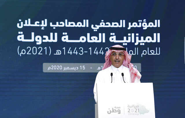 ADDS TRANSLATION - In this photo released by Saudi Press Agency, SPA, Saudi Finance Minister Mohammed al-Jadaan, speaks during a press conference to announce Saudi Arabia's annual budget, in Riyadh, Saudi Arabia, late Tuesday, Dec. 15, 2020. Arabic reads,