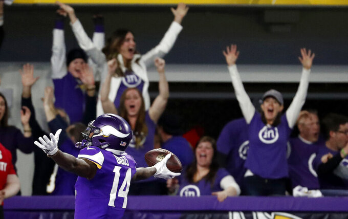 FILE - In this Jan. 14, 2018, file photo, Minnesota Vikings wide receiver Stefon Diggs (14) celebrates in the end zone after a making the game-winning touchdown against the New Orleans Saints late in the second half of an NFL divisional football playoff game in Minneapolis. This Sunday's wild-card round meeting between Minnesota and New Orleans in the Superdome will be the third playoff meeting in the past decade between the teams. (AP Photo/Jeff Roberson, File)