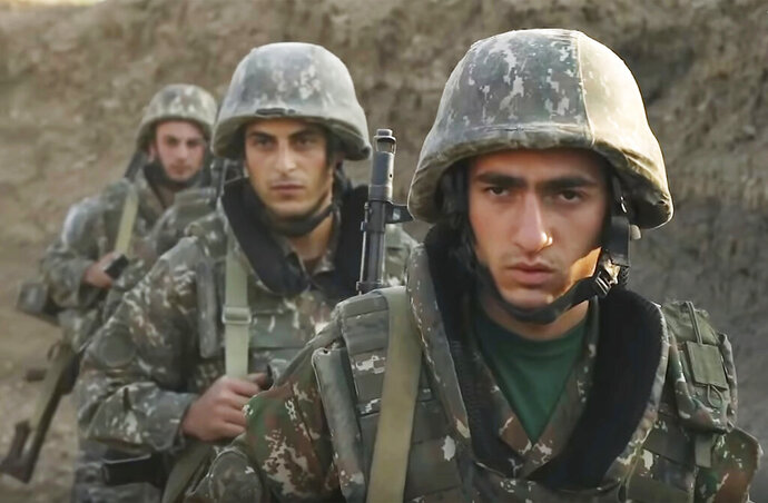 In this image taken from video released by the Armenian Defense Ministry on Wednesday, Sept. 30, 2020, Armenian solders guard their position in the self-proclaimed Republic of Nagorno-Karabakh, Azerbaijan. Armenia's Foreign Ministry in a statement