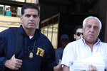 Suspect Tommaso Inzerillo, right, is taken into custody during an anti-mafia operation lead by the Italian Police and the FBI in Palermo, Southern Italy, Wednesday, July 17, 2019. Italian police and the FBI arrested 19 suspected Mafiosi in a joint operation Wednesday following an investigation which revealed alleged ties between Sicily's Cosa Nostra Mafia and New York's Gambino crime family. (Igor Petix/ANSA Via AP)