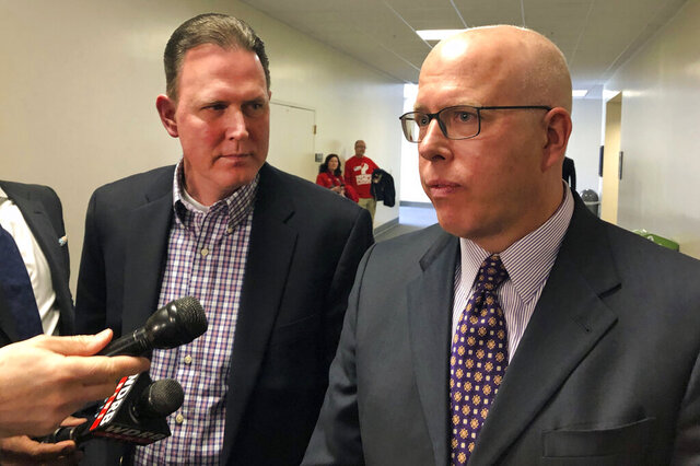 FILE - In this Wednesday, March 6, 2019, file photo, Ted Sandmann, left, and his attorney Todd McMurtry speak with reporters in Frankfort, Ky., about a bill moving through the state legislature that would make it a crime to share personally identifying information about a minor online with the intent of harassment or intimidation. Sandmann is the father of Nick Sandmann, a student at Covington Catholic High School who was vilified online for his interaction with a Native American protester in Washington. The Kentucky Senate passed legislation Monday, March 2, 2020, that would make it a crime to spread personal information of a minor online with the intent to harass, abuse or frighten. (AP Photo/Adam Beam, File)