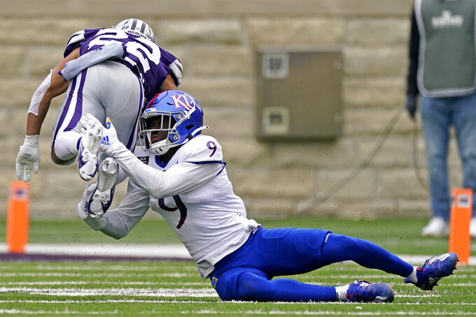 Kansas State running back Deuce Vaughn (22) is tackled by Kansas cornerback Karon Prunty (9) during the second half of an NCAA college football game Saturday, Oct. 24, 2020, in Manhattan, Kan. (AP Photo/Charlie Riedel)