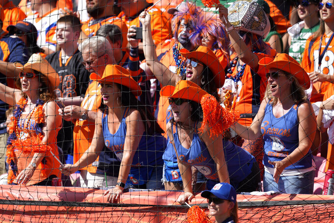 Denver Broncos fans cheer during the first half of an NFL football game against the New York Jets, Sunday, Sept. 26, 2021, in Denver. (AP Photo/David Zalubowski)