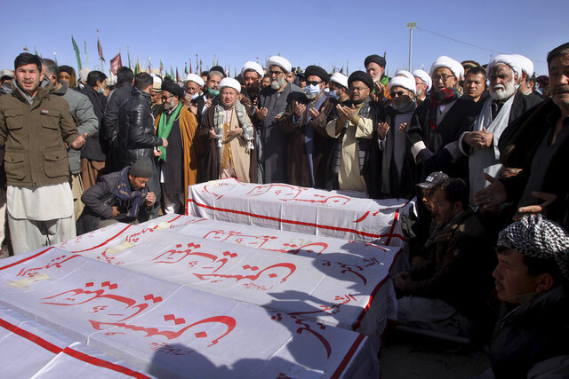 People attend the funeral prayer of coal mine workers who were killed by gunmen near the Machh coal field in Quetta, Pakistan, Saturday, Jan. 9, 2021. Hundreds of Pakistani Shiites gathered to bury 11 coal miners from the minority Hazara community who were killed by the Islamic State group, ending over a week of protests that sought to highlight the minority community's plight. (AP Photo/Arshad Butt)