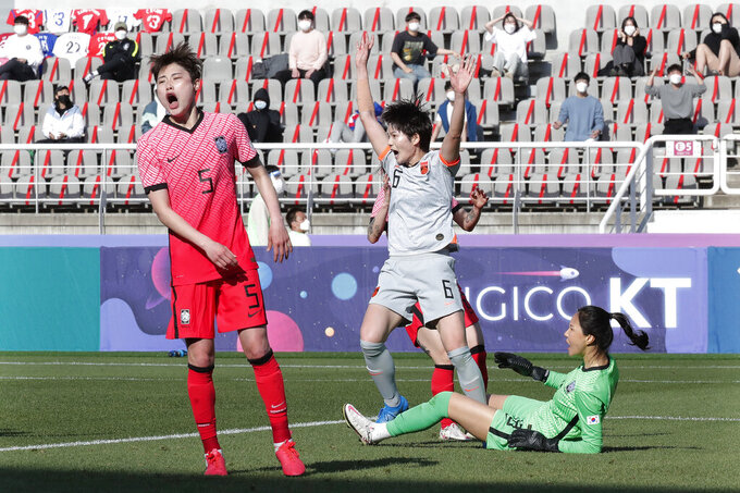 China's Zhang Xin, second from right, celebrates after scoring the first goal against South Korea during the Asian qualifying for the 2020 Tokyo Olympics at the Goyang stadium in Goyang, South Korea, Thursday, April 8, 2021. (AP Photo/Ahn Young-joon)