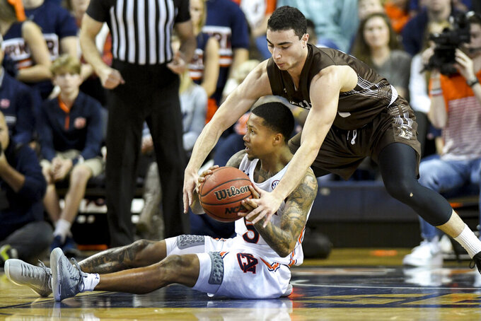 Lehigh guard Jordan Cohen (11) tries to take the ball from Auburn guard J'Von McCormick (5) during the first half of an NCAA college basketball game Saturday, Dec. 21, 2019, in Auburn, Ala. (AP Photo/Julie Bennett)