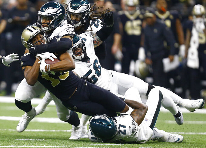 New Orleans Saints wide receiver Michael Thomas (13) is tackled by Philadelphia Eagles middle linebacker Jordan Hicks (58) in the first half of an NFL divisional playoff football game in New Orleans, Sunday, Jan. 13, 2019. (AP Photo/Butch Dill)