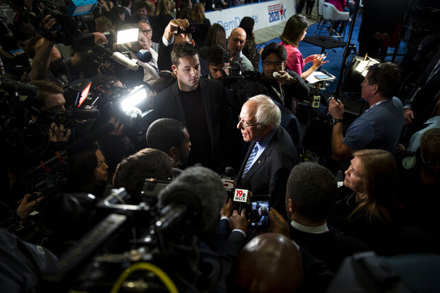 FILE - In this Tuesday, Feb. 25, 2020, file photo, Democratic presidential candidate Sen. Bernie Sanders, I-Vt., speaks with members of the media after a Democratic presidential primary debate in Charleston, S.C. As Sanders reaches out to black voters ahead of South Carolina's Saturday primary, seeking to cut into former Vice President Joe Biden's firewall of black support in the state, the Democratic front-runner's Jewish identity isn't much of a factor. (AP Photo/Matt Rourke, File)