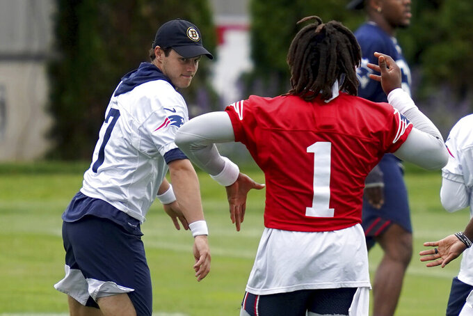 New England Patriots punter Jake Bailey and quarterback Cam Newton swing their arms during NFL football practice in Foxborough, Mass., Friday, June 4, 2021. (AP Photo/Mary Schwalm)