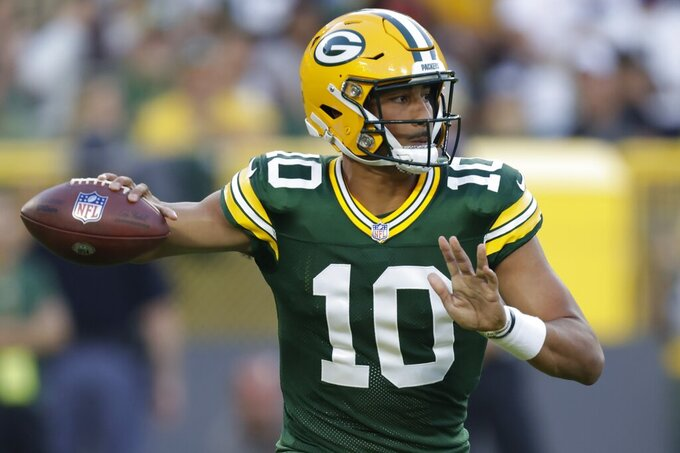 Green Bay Packers' Jordan Love throws a pass during the first half of a preseason NFL football game against the Houston Texans Saturday, Aug. 14, 2021, in Green Bay, Wis. (AP Photo/Matt Ludtke)