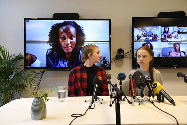 Climate activist Vanessa Nakate, left, speaks via video-link as Ell Ottosson Jarl and Greta Thunberg, right, also attend a press conference with climate activists and experts from Africa in Stockholm, Sweden, Friday Jan. 31, 2020. Ugandan climate activist Vanessa Nakate and peers from other African nations on Friday made an urgent appeal for the world to pay more attention to the continent that stands to suffer the most from global warming despite contributing to it the least. (Pontus Lundahl/TT via AP)