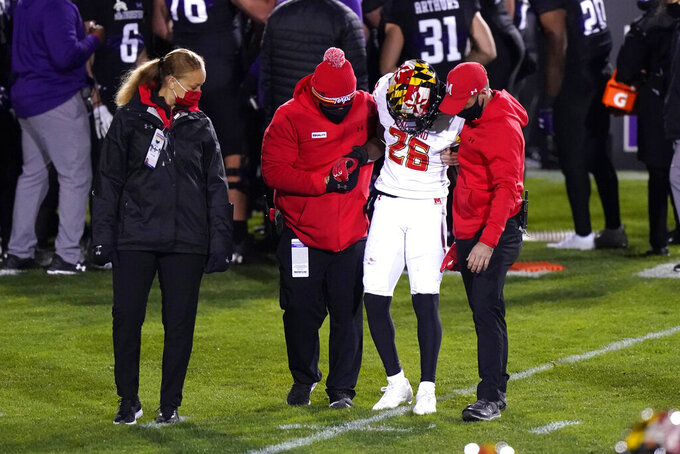 Maryland defensive back Erwin Byrd (26) is helped by trainers during the second half of an NCAA college football game against Northwestern in Evanston, Ill., Saturday, Oct. 24, 2020. (AP Photo/Nam Y. Huh)