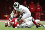 Michigan State defensive end Kenny Willekes (48) recovers a fumble for a turnover by Nebraska quarterback Adrian Martinez (2) during the first half of an NCAA college football game in Lincoln, Neb., Saturday, Nov. 17, 2018. (AP Photo/Nati Harnik)