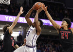 Northwestern guard Anthony Gaines, center, drives to the basket between Rutgers guard Caleb McConnell, left, and guard/forward Ron Harper Jr. during the second half of an NCAA college basketball game, Wednesday, Feb. 13, 2019, in Evanston, Ill. Rutgers won 59-56. (AP Photo/Nam Y. Huh)
