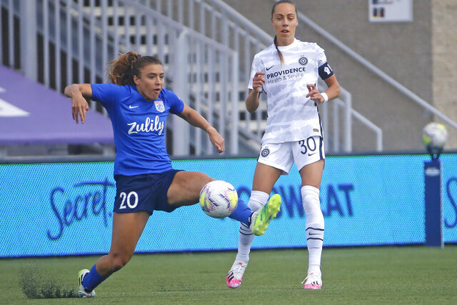 OL Reign forward Sofia Huerta (20) controls the ball as Portland Thorns midfielder Celeste Boureille (30) defends during the first half of an NWSL Challenge Cup soccer match at Zions Bank Stadium Monday, July 13, 2020, in Herriman, Utah. (AP Photo/Rick Bowmer)