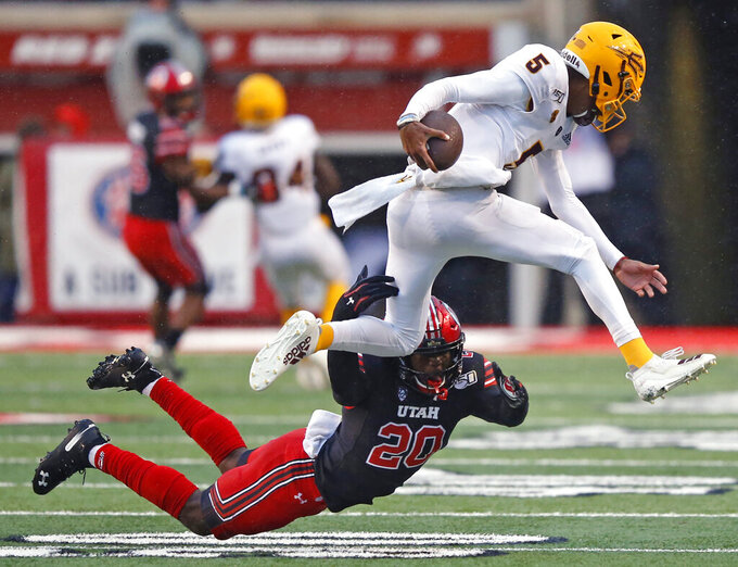 FILE - In this Oct. 19, 2019, file photo, Utah linebacker Devin Lloyd (20) tackles Arizona State quarterback Jayden Daniels (5) during the first half of an NCAA college football game in Salt Lake City. Experience is in short supply on the Utah defense as it prepares to head into the pandemic-shortened season. The Utes return only two full-time starters – junior defensive end Mika Tafua and junior linebacker Lloyd – from a unit that took the Pac-12 by storm a year ago. (AP Photo/Rick Bowmer)