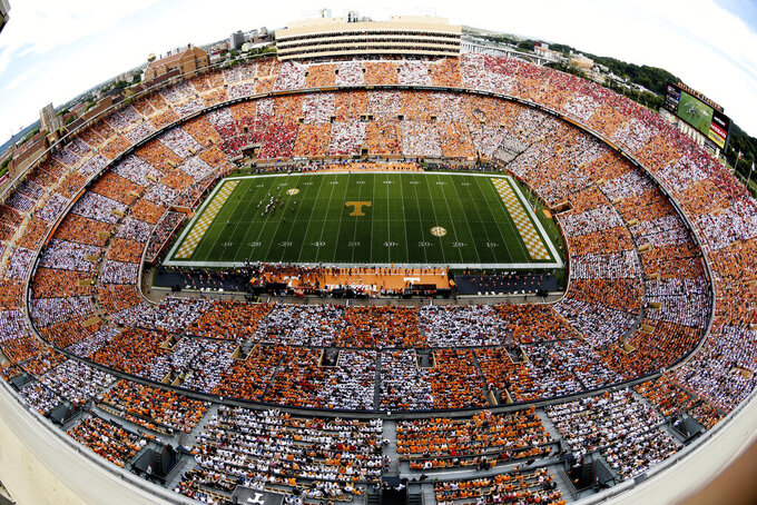 FILE - This Sept. 30, 2017, file photo shows Neyland Stadium during an NCAA college football game between Georgia and Tennessee, in Knoxville, Tenn. Tennessee will be celebrating the 100th year at Neyland Stadium all season long. The stadium currently seats 102,455, making it the fifth-largest in college football. (Michael Patrick/Knoxville News Sentinel via AP, File)