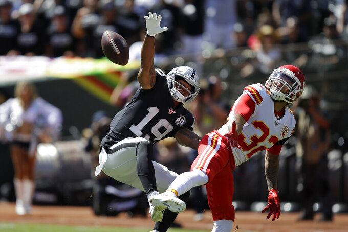 Oakland Raiders wide receiver Ryan Grant (19) goes up for a pass as Kansas City Chiefs strong safety Tyrann Mathieu looks on during the first half of an NFL football game Sunday, Sept. 15, 2019, in Oakland, Calif. A pass interference penalty was called on the play against the Chiefs. (AP Photo/Ben Margot)