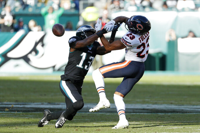 Philadelphia Eagles' Nelson Agholor, left, and Chicago Bears' Kyle Fuller battle for a pass during the first half of an NFL football game, Sunday, Nov. 3, 2019, in Philadelphia. (AP Photo/Chris Szagola)
