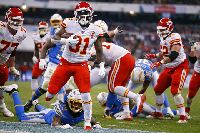 Kansas City Chiefs running back Darrel Williams scores a touchdown during the second half of an NFL football game against the Los Angeles Chargers, Monday, Nov. 18, 2019, in Mexico City. (AP Photo/Rebecca Blackwell)