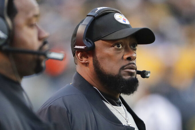 File- This Dec. 30, 2018, file photo shows, Pittsburgh Steelers head coach Mike Tomlin during an NFL football game against the Cincinnati Bengals,  in Pittsburgh. With only a handful of minorities in the stepping-stone positions of offensive coordinator and quarterbacks coach, the NFL saw its sharpest-ever one-year drop in minority head coaches, causing concern among advocates for diversity declaring unsatisfactory progress 16 years after the Rooney Rule was implemented. (AP Photo/Gene J. Puskar, File)