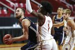 Virginia's Jay Huff, left, looks to shoot against Boston College's CJ Felder (1) during the first half of an NCAA college basketball game, Saturday, Jan. 9, 2021, in Boston. (AP Photo/Michael Dwyer)