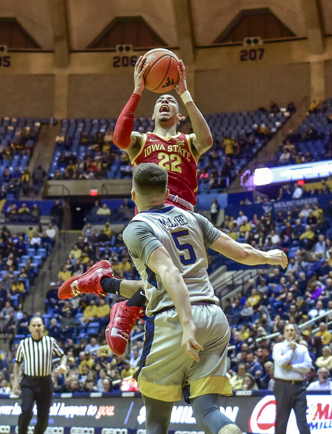 Iowa State guard Tyrese Haliburton (22) shoots over West Virginia guard Jordan McCabe (5) during the second half of an NCAA college basketball game Wednesday, March 6, 2019, in Morgantown, W.Va. (William Wotring/The Dominion-Post via AP)